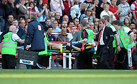 Kenny Dalglish Manager looks at the injured Jamie Carragher as he's stretchered off<br />Liverpool 2010/11<br />Arsenal V Liverpool (1-1) 17/04/11<br />The Premier League<br />Photo: Robin Parker Fotosports International