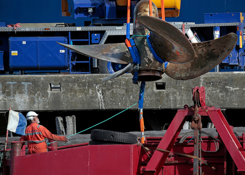 The 6.5 tonne starboard propeller of the crippled Interislander ferry Aratere is lifted out of the water by crane onto the Brandywine (Seaworks) at Picton, New Zealand, Tuesday, December 10, 2013.  The propellor was recovered from the seabed 123 metres below the surface outside Tory Channel.  Credit:SNPA / Anthony Phelps