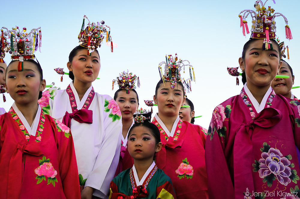 Seven year-old Irene Chu of Los Angeles (center, foreground) and fellow dancers from the 10-member Korean Yu Su Kyung Hah-Yah Traditional Dance Group wait backstage to perform a Korean fan dance to a crowd of 200 at a festival held in celebration of the Korean New Year on January 31, 2009, in Chinatown, Los Angeles, California.  Photo by Jen Klewitz