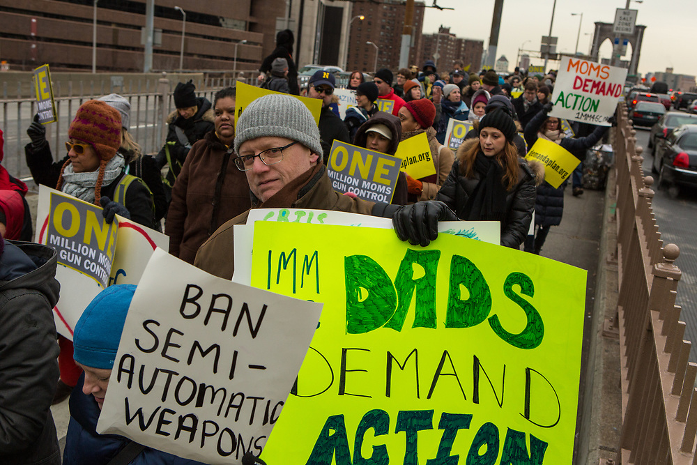"Among the marchers were a number of dads. One carries a placard reading ""Dada demand action."""