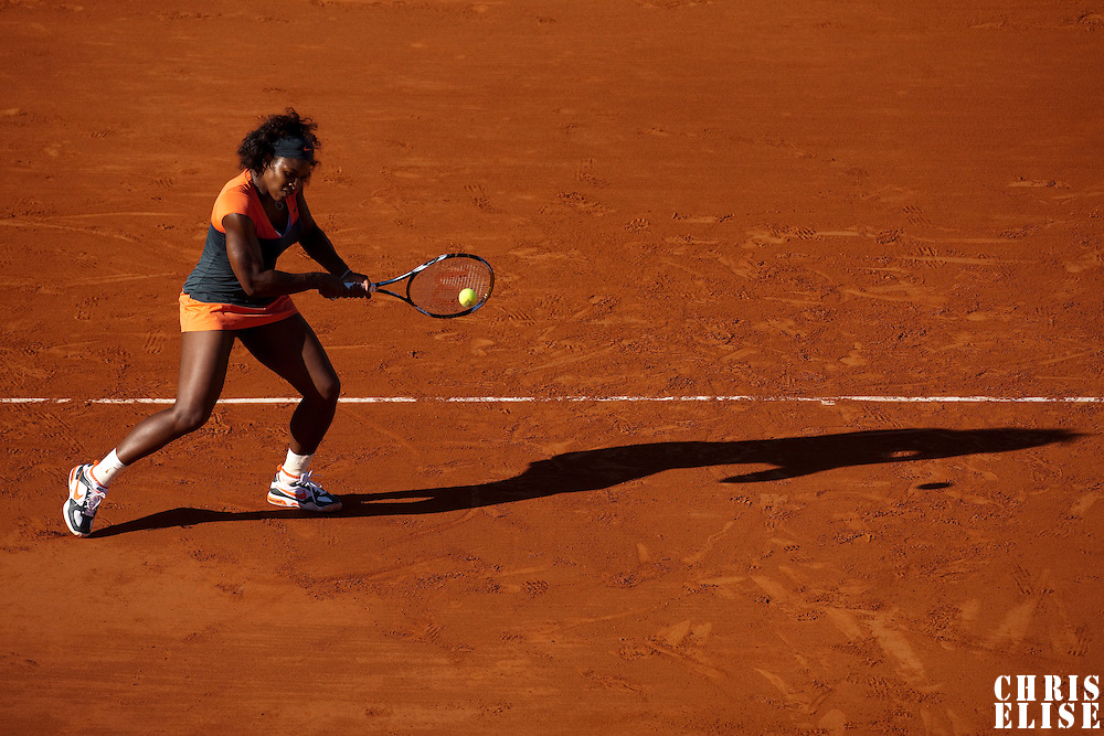 30 May 2009: Serena Williams of USA hits a backhand during the Women's Third Round match on day seven of the French Open at Roland Garros in Paris, France.