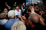 """Republican presidential candidate Mitt Romney takes his campaign on the road with his """"Every Town Counts"""" bus tour. Mitt Romney works a crowd of supporters in Cornwall, Pennsylvania."""