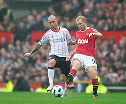 MANCHESTER, ENGLAND - Sunday, September 19, 2010: Liverpool's Raul Meireles and Manchester United's Paul Scholes during the Premiership match at Old Trafford. (Photo by David Rawcliffe/Propaganda)