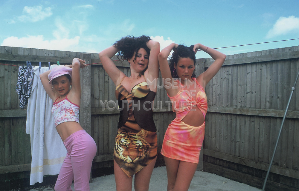 The three Doherty sisters, Priscilla, Noreen and Irene posing in revealing outfits on Winterbourne Travellers site, Bristol, UK, October 2003