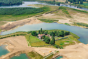 Nederland, Limburg, gemeente Stein, 07-03-2010; Meers, werkzaamheden in het kader van het project Grensmaas. Boven de Maas met verbreedde stroomgeul, de gegraven plas dient als gronddepot. <br /> Grensmaas project is een samenspel van rivierbeveiliging door stroomgeulverbreding en oeververlaging, natuurontwikkeling en ontgrinding.<br /> Meers, work under the project Meuse. The river with widened stream channel, the dug lake will serve as the soil depot.Grensmaas (Border Meuse) project is a combination of security by stream channel widening and bank reduction, habitat developement and 'de-gravelisation'.<br /> luchtfoto (toeslag op standard tarieven);<br /> aerial photo (additional fee required);<br /> copyright foto/photo Siebe Swart