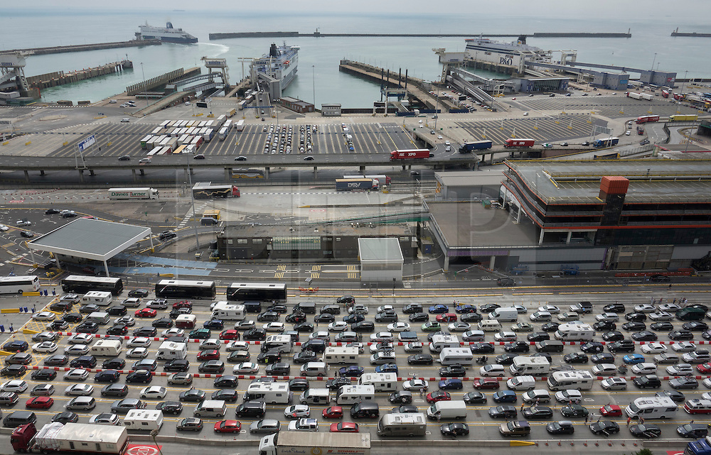 © Licensed to London News Pictures. 23/07/2016. Dover, UK.  Cars and trucks queue up to get into the port of Dover as the holding areas for ferry boarding remain mostly empty. Long delays are currently being experienced after increased security checks were put in place. Photo credit: Peter Macdiarmid/LNP