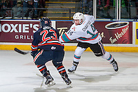 KELOWNA, CANADA - APRIL 4: Spencer Bast #23 of Kamloops Blazers tried to block a slap shot by Rourke Chartier #14 of Kelowna Rockets during first period on April 4, 2016 at Prospera Place in Kelowna, British Columbia, Canada.  (Photo by Marissa Baecker/Shoot the Breeze)  *** Local Caption *** Spencer Bast; Rourke Chartier;