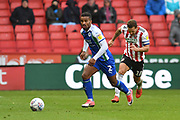 Wigan Athletic defender Nathan Byrne (2)  and Sheffield United forward Billy Sharp (10) during the EFL Sky Bet Championship match between Sheffield United and Wigan Athletic at Bramall Lane, Sheffield, England on 27 October 2018.