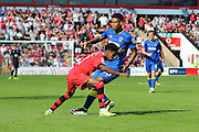 AFC Wimbledon striker Lyle Taylor (33) and Walsall FC defender Rico Henry (3) during the EFL Sky Bet League 1 match between Walsall and AFC Wimbledon at the Banks's Stadium, Walsall, England on 6 August 2016. Photo by Stuart Butcher.