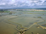 Nederland, Noord-Brabant, Drimmelen, 25-02-2020; Brabantse Biesbosch, zicht op Polder Noordwaard bij hoogwater, de polder fungeert als overloopgebied bij hoogwater. De dijken aan de rivier de Nieuwe Merwede (rechts) zijn gedeeltelijk afgegraven waardoor de rivier bij hoogwater via de Noordwaard en de Biesbosch sneller naar zee gaat stromen. Gevolg van de ingrepen in het kader van Ruimte voor de Rivier is dat de waterstand verder stroomopwaarts zal dalen. Huizen en boerderijen zijn verplaatst naar nieuw aangelegde terpen.<br /> Brabantse Biesbosch, view of Polder Noordwaard during high waters. The Noordwaard Polder serves as an overflow area and gives 'Room to the River'. Houses and farmhouses have been demolished and rebuild on new dwelling mounds.<br /> luchtfoto (toeslag op standard tarieven);<br /> aerial photo (additional fee required)<br /> copyright © 2020 foto/photo Siebe Swart