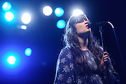 Zooey Deschanel and M. Ward performing as She and Him performing at LouFest in St. Louis on August 29, 2010.