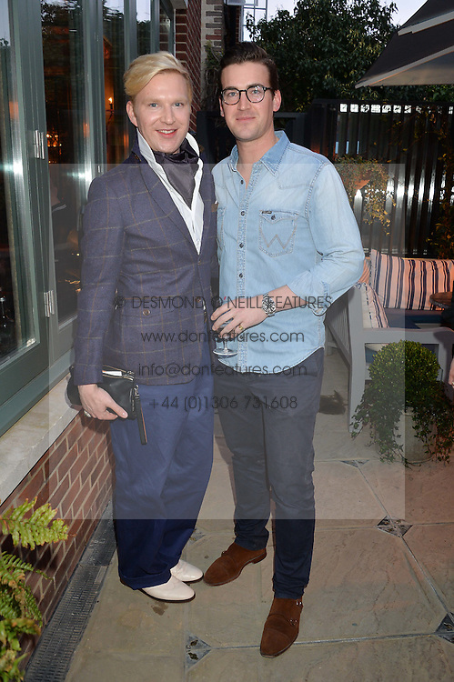 PICTURE SHOWS:-Left to right, HENRY CONWAY and FREDDIE CONWAY.<br /> Tuesday 14th April 2015 saw a host of London influencers and VIP faces gather together to celebrate the launch of The Ivy Chelsea Garden. Live entertainment was provided by jazz-trio The Blind Tigers, whilst guests enjoyed Mo&euml;t &amp; Chandon Champagne, alongside a series of delicious canap&eacute;s created by the restaurant&rsquo;s Executive Chef, Sean Burbidge.<br /> The evening showcased The Ivy Chelsea Garden to two hundred VIPs and Chelsea<br /> residents, inviting guests to preview the restaurant and gardens which marry<br /> approachable sophistication and familiar luxury with an underlying feeling of glamour and theatre. The Ivy Chelsea Garden&rsquo;s interiors have been designed by Martin Brudnizki Design Studio, and cleverly combine vintage with luxury, resulting in a space that is both alluring and down-to-earth.