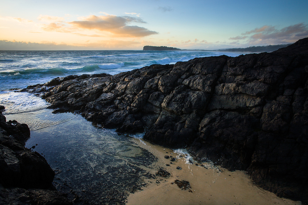 Sunrise at Middle Rocks on Fraser Island. Indian Head's distinctive shape can be clearly seen in the background. Great Sandy National Park.