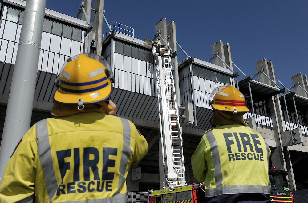 Fire crews make repairs to the roof at McLean Park after sections started to come loose in high winds, Napier, New Zealand, Saturday, September 28, 2013. Credit:SNPA / Kerry Marshall