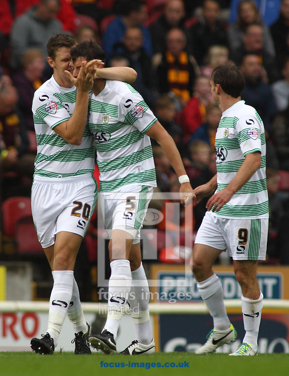 Aaron Martin (C) of Yeovil Town celebrates scoring the his goal with team mate Ben Nugent (L) and James Hayter(R) against Bradford City during the Sky Bet League 1 match at the Coral Windows Stadium, Bradford<br /> Picture by Stephen Gaunt/Focus Images Ltd +447904 833202<br /> 06/09/2014
