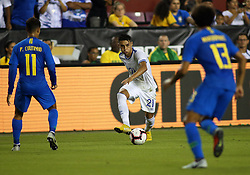 September 11, 2018 - Landover, MD, U.S. - LANDOVER, MD - SEPTEMBER 11: El Salvador defender Bryan Tamacas (21) looks to slip past several Brazil defenders during a match between Brazil and El Salvador on September 11, 2018, at FedExField in Landover, MD. (Photo by Daniel Kucin Jr./Icon Sportswire) (Credit Image: © Daniel Kucin Jr/Icon SMI via ZUMA Press)