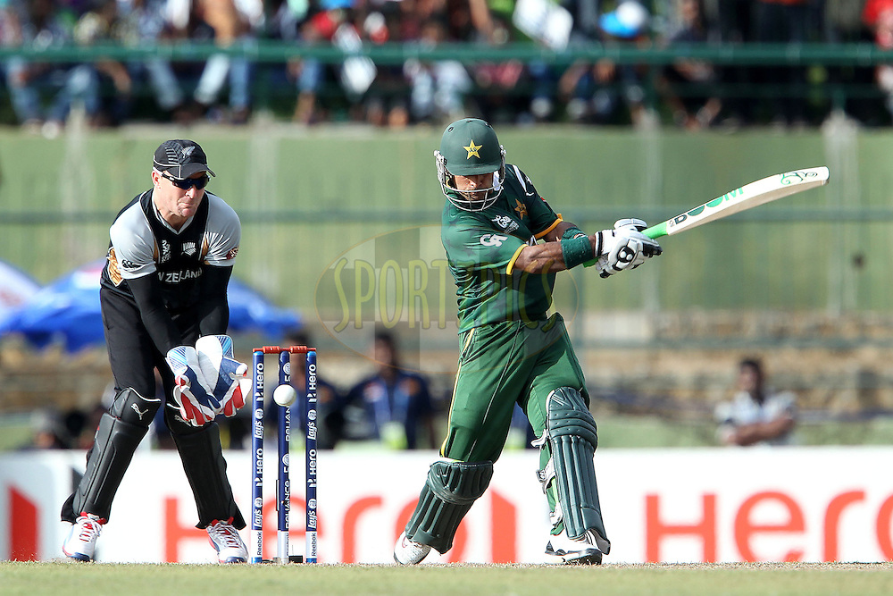 Mohammad Hafeez is clean bowled by James Franklin during the ICC World Twenty20 Pool match between Pakistan and New Zealand held at the  Pallekele Stadium in Kandy, Sri Lanka on the 23rd September 2012..Photo by Ron Gaunt/SPORTZPICS/PHOTOSPORT