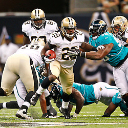 August 17, 2012; New Orleans, LA, USA; New Orleans Saints running back Chris Ivory (29) breaks a tackle of Jacksonville Jaguars defensive tackle Terrance Knighton (96) during the second half of a preseason game at the Mercedes-Benz Superdome. The Jaguars defeated the Saints 27-24.  Mandatory Credit: Derick E. Hingle-US PRESSWIRE