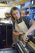 Windsor, Canada, 2014. Emily Davidson puts ink on a letter press during a printing workshop at  Windsor Printmakers Forum as part of her Neighbourhood Spaces residency. Neighbourhood Spaces, a Windsor community art program, invited Davidson, a political artist from Halifax, Nova Scotia, on the basis of her proposal.