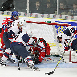 COBOURG, - Dec 14, 2015 -  Game #3 - United States vs Czech Republic at the 2015 World Junior A Challenge at the Cobourg Community Centre, ON.  Team USA battles for the puck during the second period.(Photo: Tim Bates / OJHL Images)