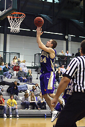 30 December 2006: Dean Raven up for a lay up. The Titans outscored the Britons by a score of 94-80. The Britons of Albion College visited the Illinois Wesleyan Titans at the Shirk Center in Bloomington Illinois.<br />