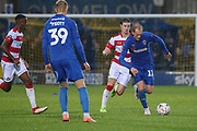 AFC Wimbledon midfielder Mitchell (Mitch) Pinnock (11) dribbling during the The FA Cup match between AFC Wimbledon and Doncaster Rovers at the Cherry Red Records Stadium, Kingston, England on 9 November 2019.