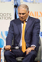 Gov. Jay Inslee, as well as three other Democratic Presidential hopefuls Sen. Elizabeth Warren, Sen. Kirsten Gillibrand and Sec. Julian Castro react to questions during the Daily Kos/Netroots Nation candidate forum, at the Convention Center in Philadelphia, PA, on July 13, 2019.