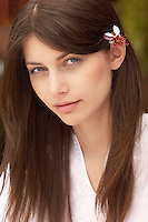 Woman with flower in hair portrait