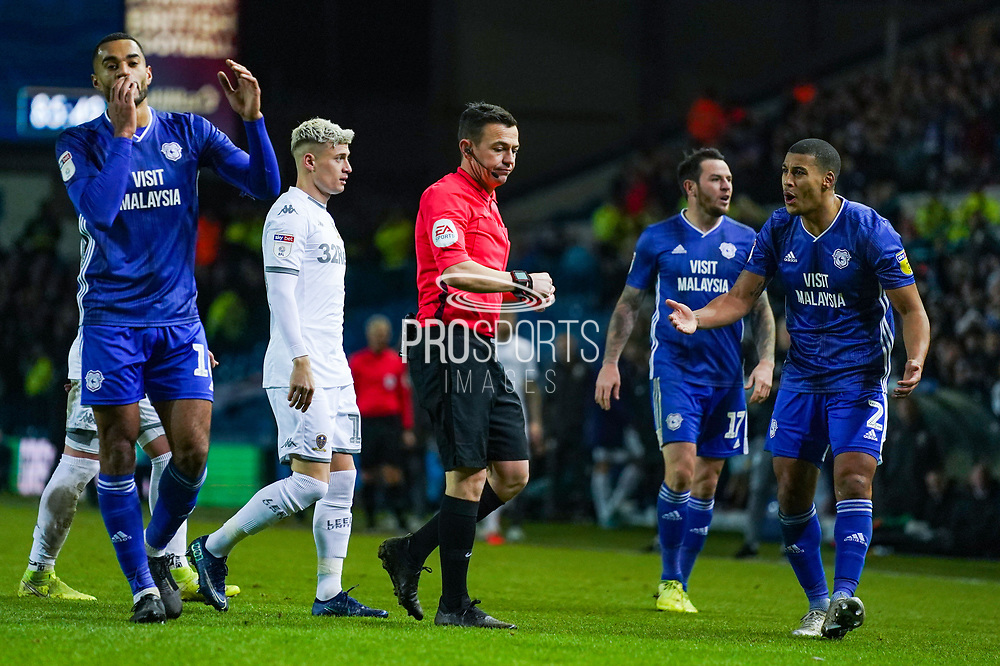 Cardiff City defender Lee Peltier (2) reacts to Tony Harrington (Referee) showing Cardiff City defender Sean Morrison (4) a red card during the EFL Sky Bet Championship match between Leeds United and Cardiff City at Elland Road, Leeds, England on 14 December 2019.