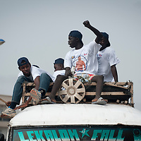02/07/2012. Senegal, Dakar. One day with the White Lion.    The canarian wrestler Juan Espino, the unique white fighter in the senegalese wrestling. White Lion's fans sing and shout perched on the roof of a bus. ©Sylvain Cherkaoui