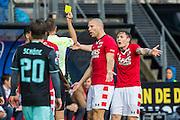 ALKMAAR - 06-11-2016, AZ - Ajax, AFAS Stadion, 2-2, scheidsrechter Pol van Boekel geeft de gele kaart aan AZ speler Mattias Johansson (r), AZ speler Ron Vlaar
