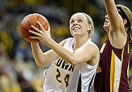 February 18, 2010: Iowa guard Jaime Printy (24) drives around Minnesota forward Brianna Mastey (41) to the basket during the second half of the NCAA women's basketball game at Carver-Hawkeye Arena in Iowa City, Iowa on February 18, 2010. Iowa defeated Minnesota 75-54.