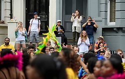 © Licensed to London News Pictures. 29/08/2016. London, UK. Members of the public photograph carnival goers as they take part in day two of the Notting Hill carnival, the second largest street festival in the world after the Rio Carnival in Brazil, attracting over 1 million people to the streets of West London.  Photo credit: Ben Cawthra/LNP
