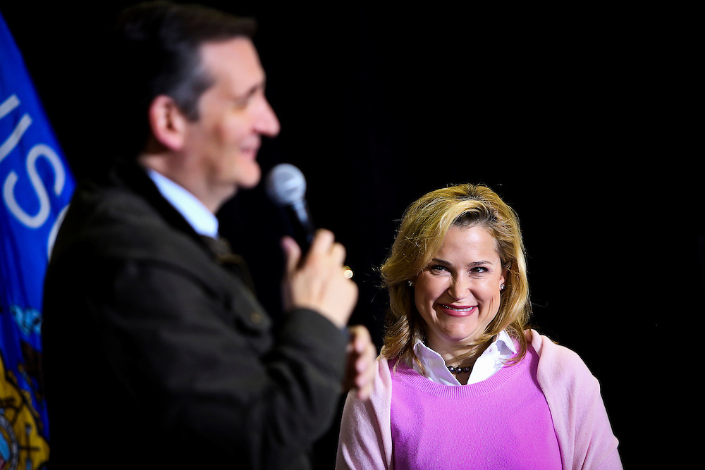 Heidi Cruz, right, wife of Presidential candidate Ted Cruz, R-Tx, laughs as her husband speaks to the crowd at Dane Manufacturing, a small metal fabrication company in a suburb of Madison, Wisconsin on March 24, 2016. Cruz will be campaigning around the state in advance of the Wisconsin Presidential primary to be held on April 5. REUTERS/Ben Brewer