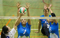 Peng Giyuan of China vs Larisa Pirih of Slovenia and Danica Gosnak of Slovenia during friendly Sitting Volleyball match between National teams of Slovenia and China, on October 22, 2017 in Sempeter pri Zalcu, Slovenia. (Photo by Vid Ponikvar / Sportida)