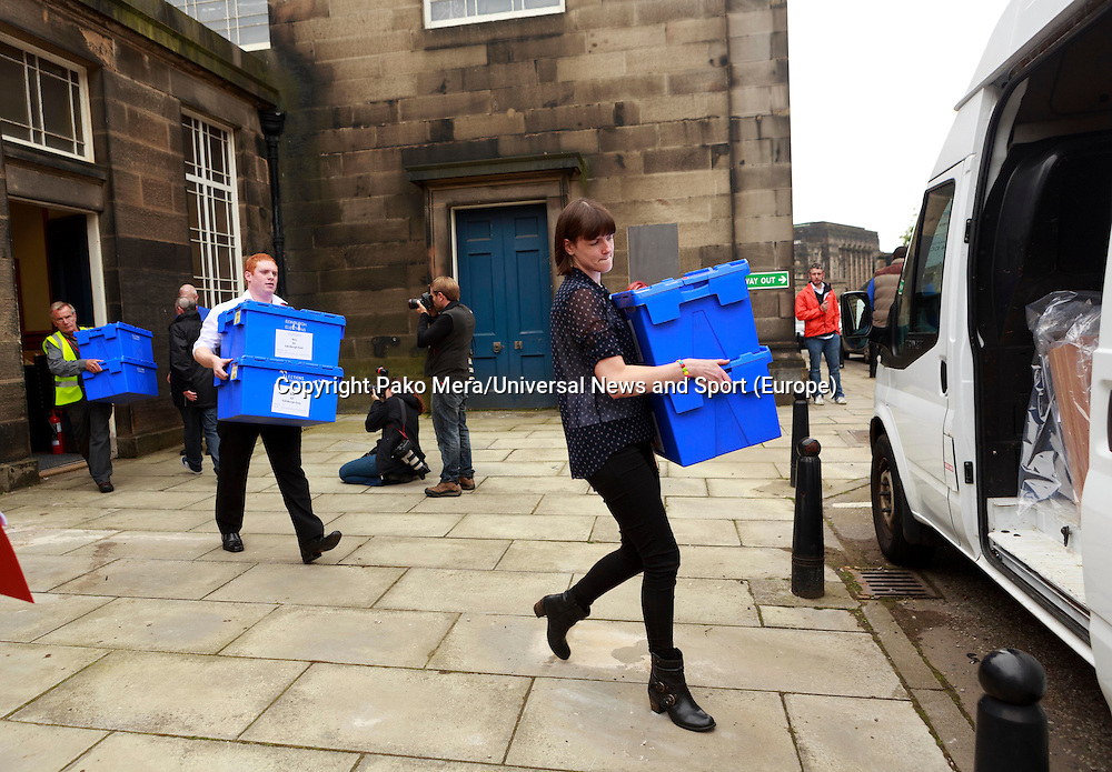 Council workers carrying ballot boxes to the van.<br /> Ballot boxes delivered. Ballot boxes to be used for voting in the Scottish independence referendum will be picked up by van from storage for delivery to Edinburgh's 145 polling places. .<br /> Pako Mera/Universal News And Sport (Europe)17/09/2014