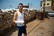 Alawite Jabal Mohsen neighborhood. Sandbags and fabric protect against Sunni snipers. Nader, an Alawite civilian, was wounded. A rifle grenade exploded near him while he was on his scooter...Quartier alaouite Jabal Mohsen. Sacs de sable et bâches protègent contre des snipers sunnites. Nader, un civil alaouite blessé. Une grenade a fusil a explosé près de lui alors qu'il était sur son scooter.