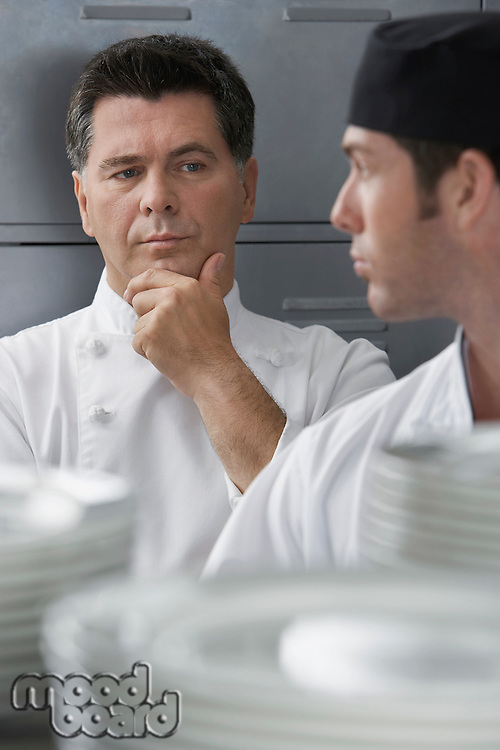 Male chef supervising trainee in kitchen