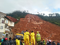 August 14, 2017 - Rescuers and a mechanical digger work at the site of mudslide during a rescue operation in Freetown, Sierra Leone. Government of Sierra Leone is expected on Tuesday to undertake the burial of the majority of corpses of victims in the devastating mudslide which had claimed nearly 300 lives. (Credit Image: © Wang Bo/Xinhua via ZUMA Wire)