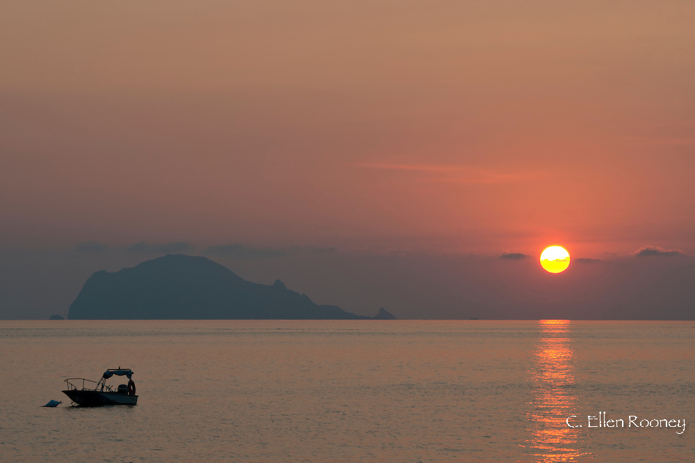 A view to Panarea from Salina Island at sunrise in The Aeolian Islands, Messina Sicily, Italy