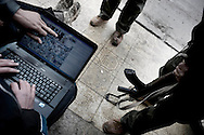 SYRIA - Al Qsair. Syrian reporters try to find on Google Maps an alternative way to reach the hospital of Al Qsair to document the ongoing clashes between Free Syrian Army and Regime Army, on January 25,  2012. Al Qsair is a small town of 40000 inhabitants, located 25Km south-west of Homs. The town is besieged since the beginning of November and so far it counts 65 dead.In all Syria there are hundreds of non-professional reporters who without experience and without proper gear keep documenting, day after day, the crackdown of the regime. This series of pictures is dedicated to them... to this colleagues who among every kind of difficulties and risks let know to the word their stories and drama.  ALESSIO ROMENZI
