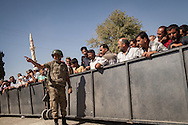 Syrian Kurdish refugees wait to return to their native Kobani, but Turkish authorities prevent them for some time at the Mürşitpınar border crossing in Şanlıurfa province, southern Turkey.