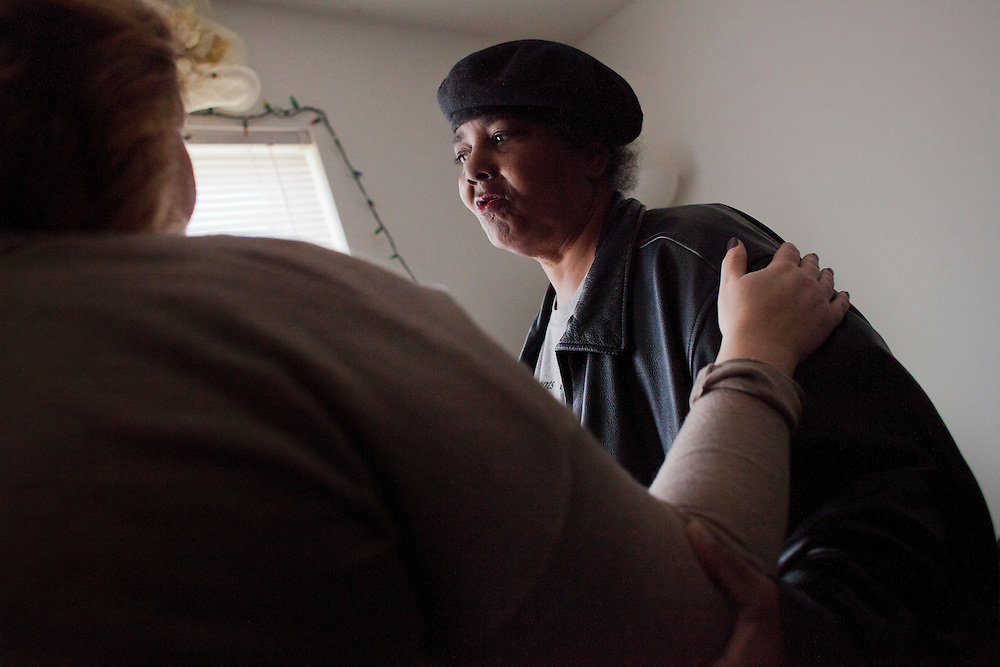 "Horizons volunteer coordinator Anna Ronnebaum holds Meals on Wheels client Michelle Dawson at Dawson's home in Cedar Rapids, Iowa on Thursday, November 19, 2015. Michelle, who lately has been suffering after a violent incident at her home, confided her story to Ronnebaum, who then tried to comfort her during the short lunchtime delivery. ""I'll have to make sure I get this route again next week so I can go check on her,"" said Ronnebaum after leaving the apartment. (Rebecca F. Miller/Freelance for The Gazette)"