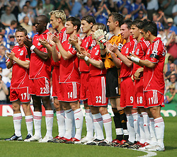 Portsmouth, England: Saturday, April 28, 2007: Liverpool players take part in the minutes applause after the death of Alan Ball before the Premiership match against Portsmouth at Fratton Park (Pic by Chris Ratcliffe/Propaganda)