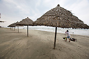 Cuai Dai Beach. Victoria Hoi An Beach Resort & Spa. A typhoon out at sea makes the waves go high. People collecting driftwood.