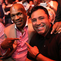 Hall of Fame boxer Mike Tyson and this years inductee Oscar De La Hoya are seen during the Iron Mike Productions, ESPN Friday Night Fights boxing match at Turning Stone Resort Casino on Friday, June 6, 2014 in Verona, New York.  (AP Photo/Alex Menendez)