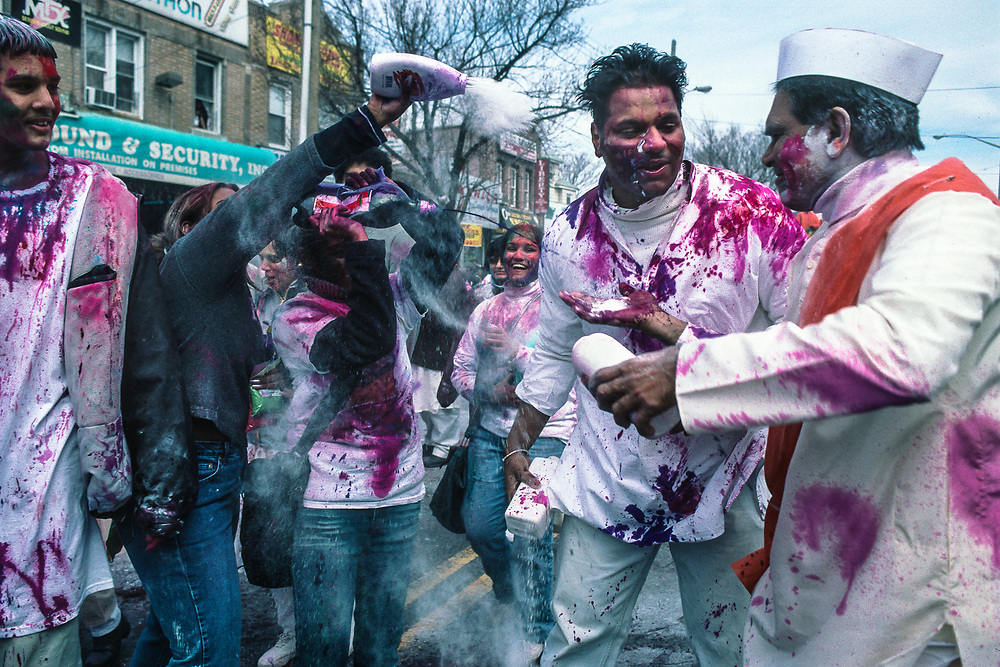 Richmond Hill, New York: Revelers celebrate Phagwah, the spring festival of colors, on the streets of New York's largest Indo-Caribbean neighborhood. Commonly known as Holi in Hindi, Phagwah comes from Bhojpuri dialect of the north Indian regions where many Indians from Guyana, Trinidad, and Suriname trace their heritage.