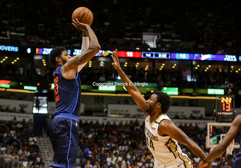 Apr 1, 2018; New Orleans, LA, USA; Oklahoma City Thunder forward Paul George (13) shoots over New Orleans Pelicans forward Solomon Hill (44) during the first quarter at the Smoothie King Center. Mandatory Credit: Derick E. Hingle-USA TODAY Sports