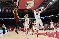 FAYETTEVILLE, AR - DECEMBER 9:  Daniel Gafford #10 of the Arkansas Razorbacks tries to block the jump shot by Isaiah Washington #11 of the Minnesota Golden Gophers at Bud Walton Arena on December 9, 2017 in Fayetteville, Arkansas.  The Razorbacks defeated the Golden Gophers 95-79.  (Photo by Wesley Hitt/Getty Images) *** Local Caption *** Daniel Gafford; Isaiah Washington