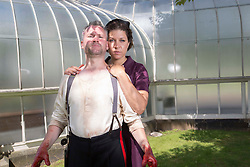 Pictured:   Bard in the Botanics  The latest production features a version of Macbeth set in 1950s, directed by Gordon Barr. Kirk Bage (Macbeth) and Nicole Cooper (Lady Macbeth)  have blood on their hands as they perform the murder of Duncan scene on the main stage<br />